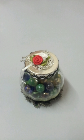 Marbles inside round container