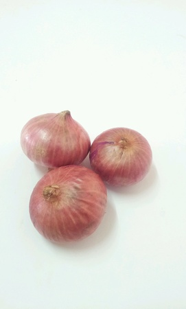 Fresh red onions isolated white background