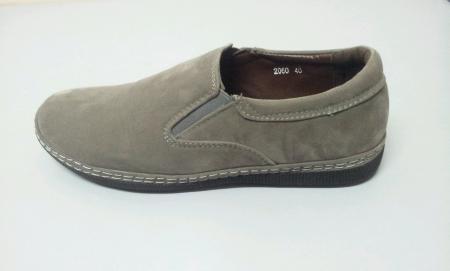 Left grey shoe isolated white background