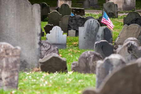 burying: American flag attached to a grave in the Granary Burying Ground in Boston