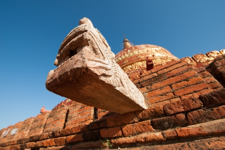 Dragon style water drainage pipe on the Damayzaka Pagoda in Bagan, Myanmar photo