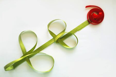Rose of green and red satin ribbons, isolated object on white background