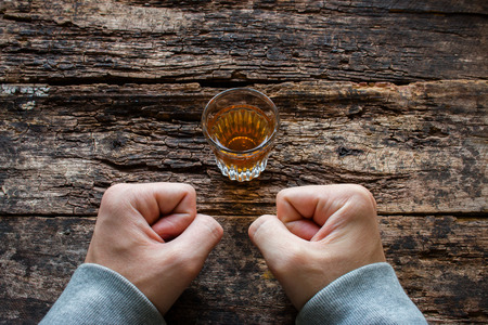 sobriety: man shows willpower not to drink alcohol