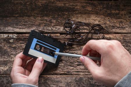 tape player: man rewind a cassette tape