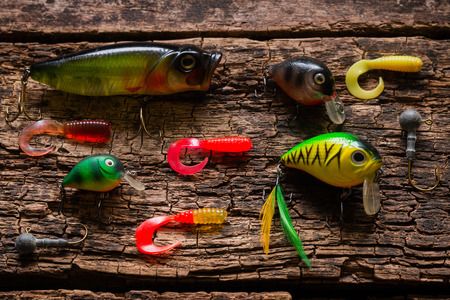 hand line fishing: bait to catch fish on a wooden background Stock Photo