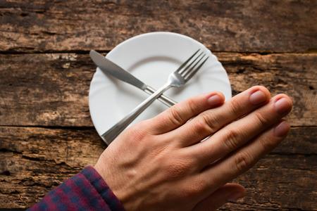 refusal: man shows refusal to eat
