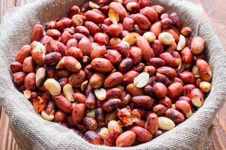 earthnuts: roasted peanuts in a sack close up