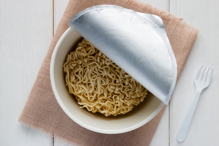 cooked instant noodle: instant noodles in a box on a white background