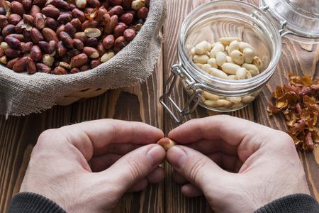 earthnuts: man cleans roasted peanuts Stock Photo