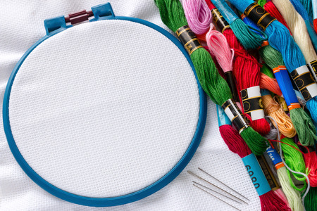 materials for handicraft hoop needle and floss Stock Photo