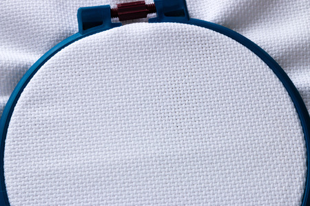 background material: blue circle and the fabric for embroidery closeup Stock Photo