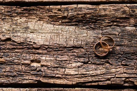 bereaved: gold rings on a wooden background