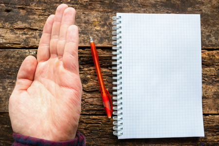 adult  body writing: man show the problem lefties - the marks of the spring notebook on the arm