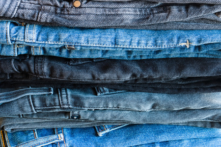 stack of different jeans closeup Stock Photo