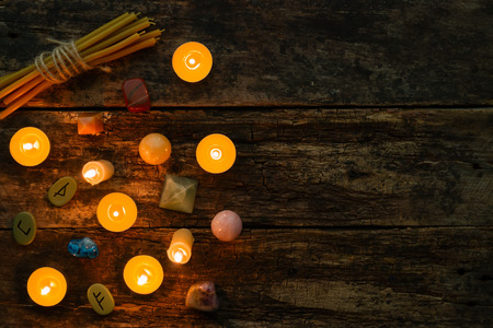 objects for divination, runes and candle on a wooden background Stock Photo