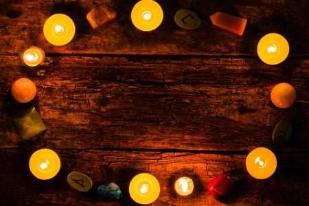 candles, stones for divination and runes on wooden background mockup Reklamní fotografie