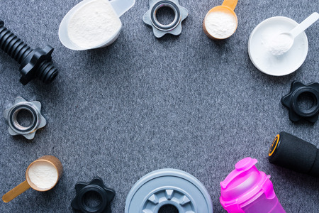 casein: dumbbells and nutritional supplements for bodybuilding mockup