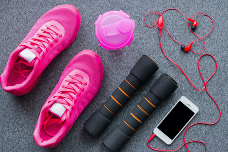 sports equipment for fitness training on a gray background Stock Photo
