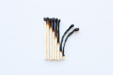 stage of burning matches on a white background closeup