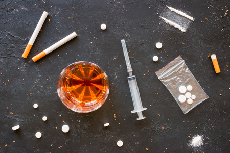 willpower: Alcohol, cigarettes and drugs on a black background