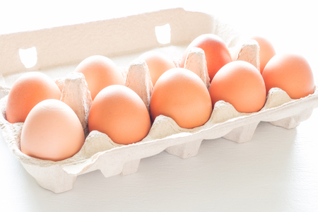 Chicken eggs in a box close-up Stock Photo