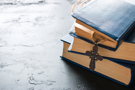Bible books and christian cross close up