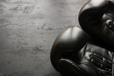 boxing gloves close-up on a black background with space for text