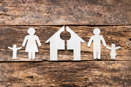 paper family and a cut house concept divorce Stock Photo