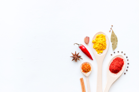 spices and condiments in spoons on a white background mockup Standard-Bild