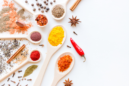 Spices and herbs on a white background with place for text Standard-Bild