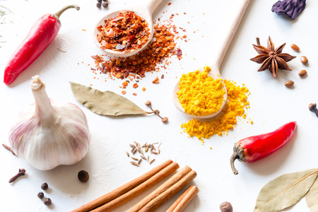 multicolored spices and herbs on a white background Standard-Bild