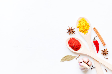spices and herbs in spoons on a white background mockup