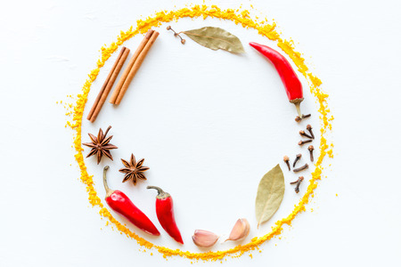 Spices and herbs in the form of a circle with space for text Standard-Bild