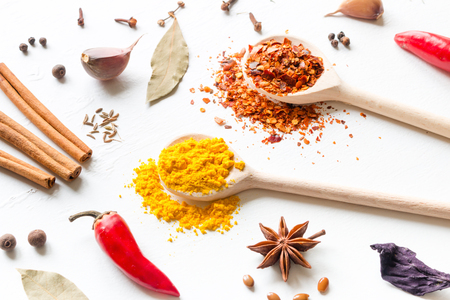 various seasonings and spices on a white background