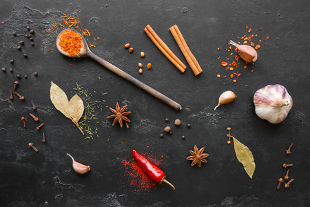 herbs spices and condiments on a black background