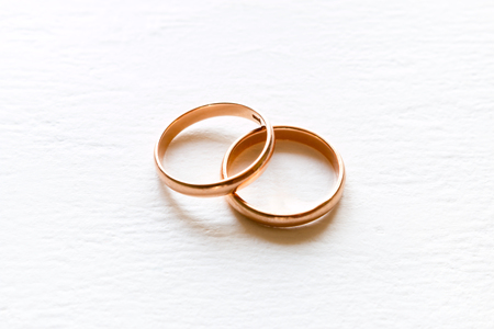 wedding rings on white background closeup