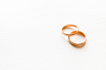 wedding rings on a white background close-up with place for text Standard-Bild