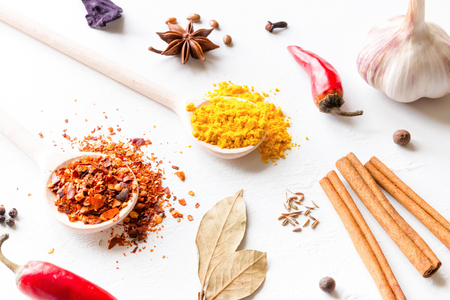 multi-colored spices and herbs on white background close-up