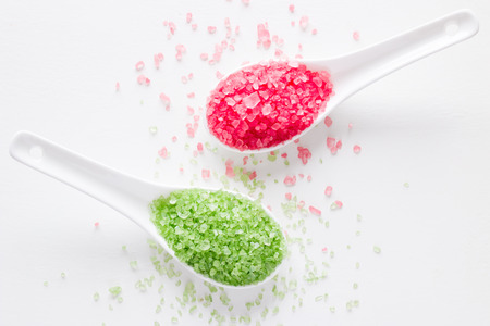 spa bath salt green and red on a white background