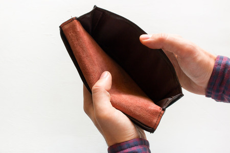 man opens the wallet, and there is no money Stock Photo