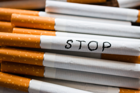 inscription stop on a cigarette. stop smoking concept Stock Photo