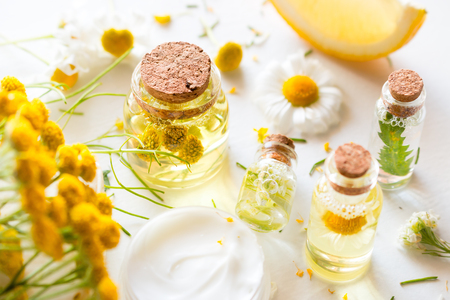 bottles with natural cosmetics from wildflowers close-up Stock Photo