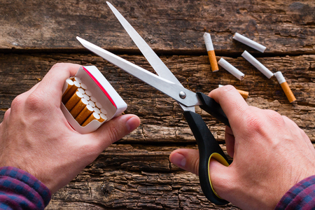 smoker quit smoking and scissors cutting cigarettes