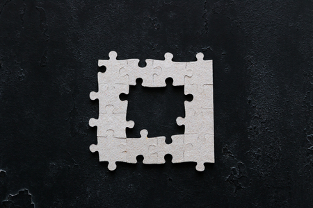 puzzle with missing parts on black background business concept