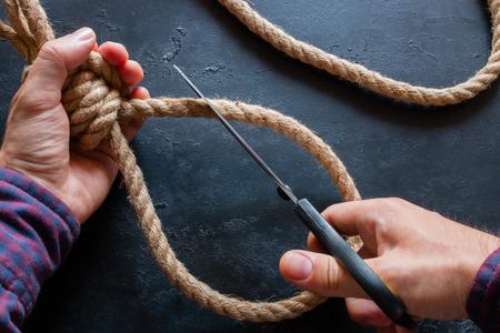 man cuts a noose concept stop a suicide