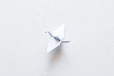 paper origami crane on white background. World Crane Day
