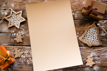 empty christmas letter on wooden background