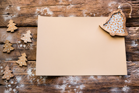 empty christmas letter and wooden ornaments