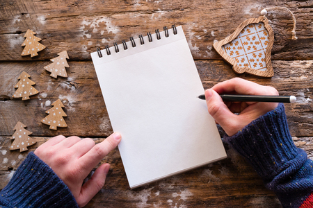 writes Christmas letter on wooden background Stock Photo