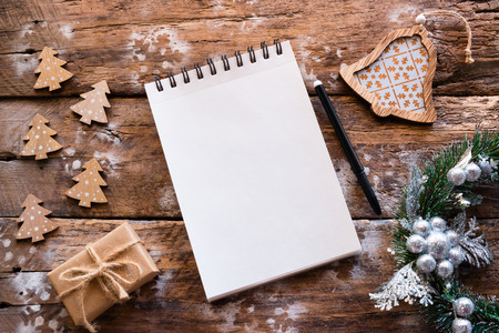 blank page of notebook for christmas letter on wooden background Stock Photo